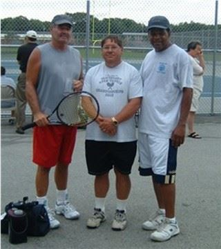 Three men, one holding a tennis raquet