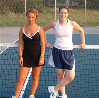 Two women in front of a tennis net