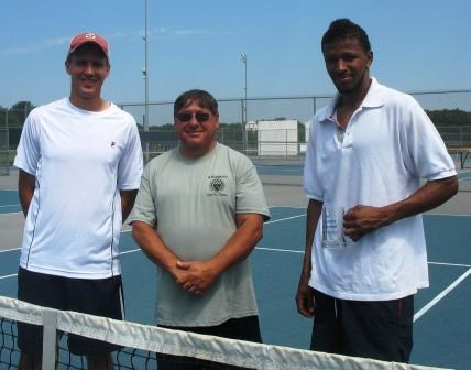 Three men behind a tennis net