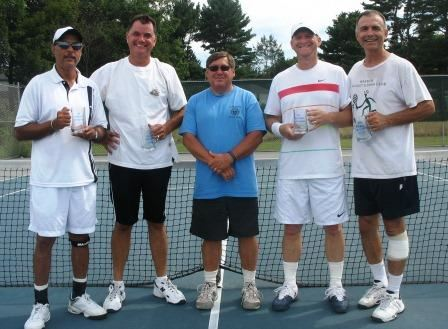 Five men in front of a tennis net