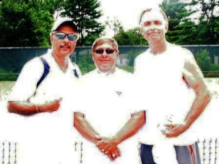 Three men wearing white