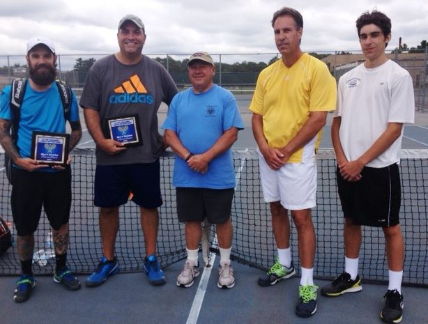 Five men in front of a tennis net, two men have awards