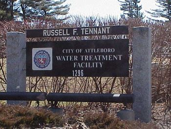 "A sign reading ""Russell F. Tennant Water Treatment Facility."""
